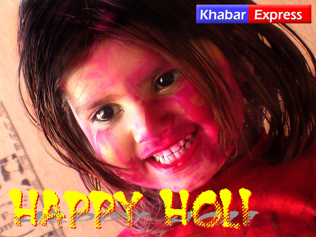Wallaper of Indian baby, wishing Happy Holi
