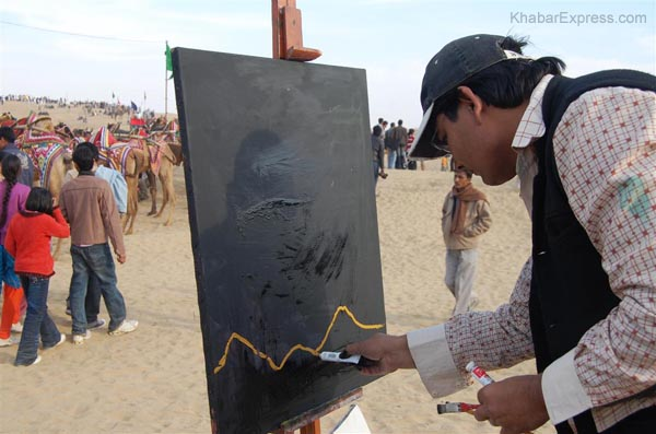 Artist making a painting in second day event of Camle Festival 2009 at Ladera Village, Bikaner