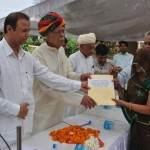 Burdak and Beniwal handover the papers of CM Residential Scheme