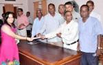 RAS K M Dudiya presenting Certificate to a girl