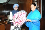 Newly elected Rajasthan CM Vasundhara Raje Met PM Manmohan Singh at New Delhi