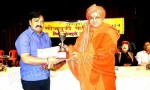 Sr Journalist Tarkeshwar Mishra receive award at Bhojpuri Festival 2014 held at Kolkata