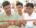 O P Punia, Principal of Engineering College of Bikaner inaugurating  new ATM of OBC Bank at Campus
