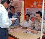 Visitors getting information about schemes of home loan and deposit in a camp of Bank of Baroda