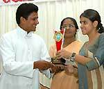 Highest scorer student of Sophia School recieving honour from pricipals of BBS and Sophia School