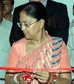 CM Raje inaugurating an art exhibition at Bikaner House in New Delhi