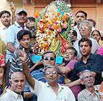 Joshiwara, Bikaner resident going to immersed Ganesh Statue into water bodies