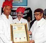 Former MLA Gopal Joshi honoring to Surendra Vyas, President Bikaner Wholesale Ltd