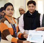 Guests givng certificate to participant during Woemn Networking and Web Designing Camp