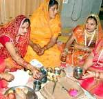 Women offering pooja and listens Katha on Kajli (Badi) Teej