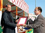 Writer and PRO receiving reward from Ashok Gehlot at State Level Function held at Jaipur