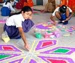 Girls making Rangoli on World Literate Day celebration by District Saksharta Samittee at MS School
