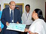 Arun Shandilya GM - SBBJ gifting One Crore Rupees Cheque to the CM Raje for the Jaipur Bomb Blaster
